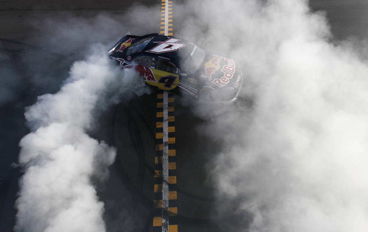 Kasey Kahne does a burnout at the finish line after winning the NASCAR Sprint Cup Series auto race at Phoenix International Raceway, Sunday, Nov. 13, 2011, in Avondale, Ariz. (AP Photo/Jonathan Ferrey, Pool)