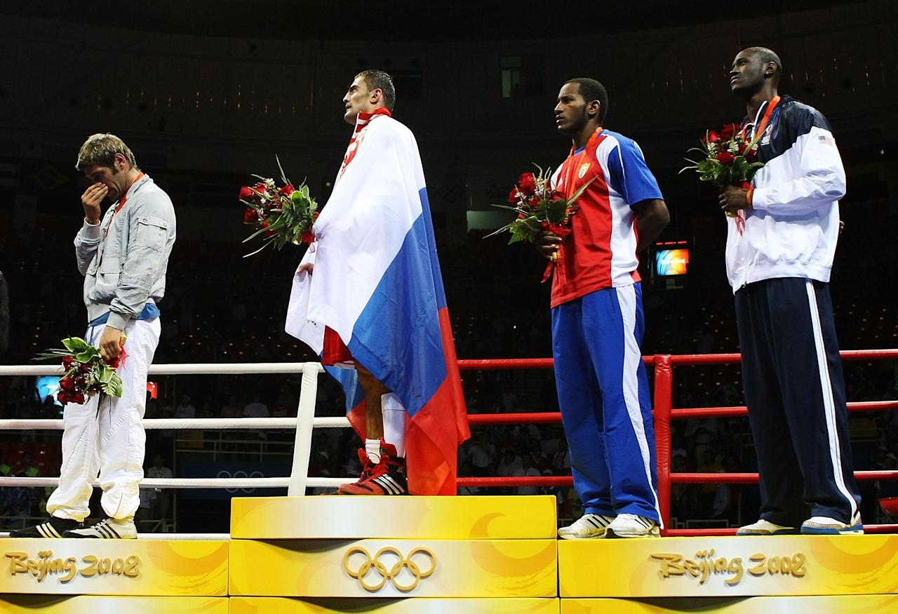 BEIJING - AUGUST 23:  (L-R) Silver medalist Clemente Russo of Italy, gold medalist Rakhim Chakhkiev of Russia and bronze medalists Osmai Acosta Duarte of Cuba and Deontay Wilder of the United States stand on the podium during the medal ceremony for the Men's Heavy (91kg) Final Bout held at Workers' Indoor Arena on Day 15 of the Beijing 2008 Olympic Games on August 23, 2008 in Beijing, China.  (Photo by Nick Laham/Getty Images)