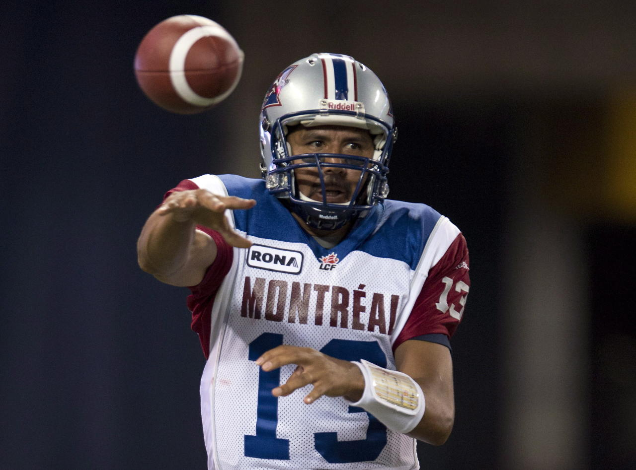 Montreal Alouettes quarterback Anthony Calvillo (13) throws during first half CFL exhibition action against the Toronto Argonauts in Toronto on Tuesday June 19, 2012. THE CANADIAN PRESS/FRANK GUNN