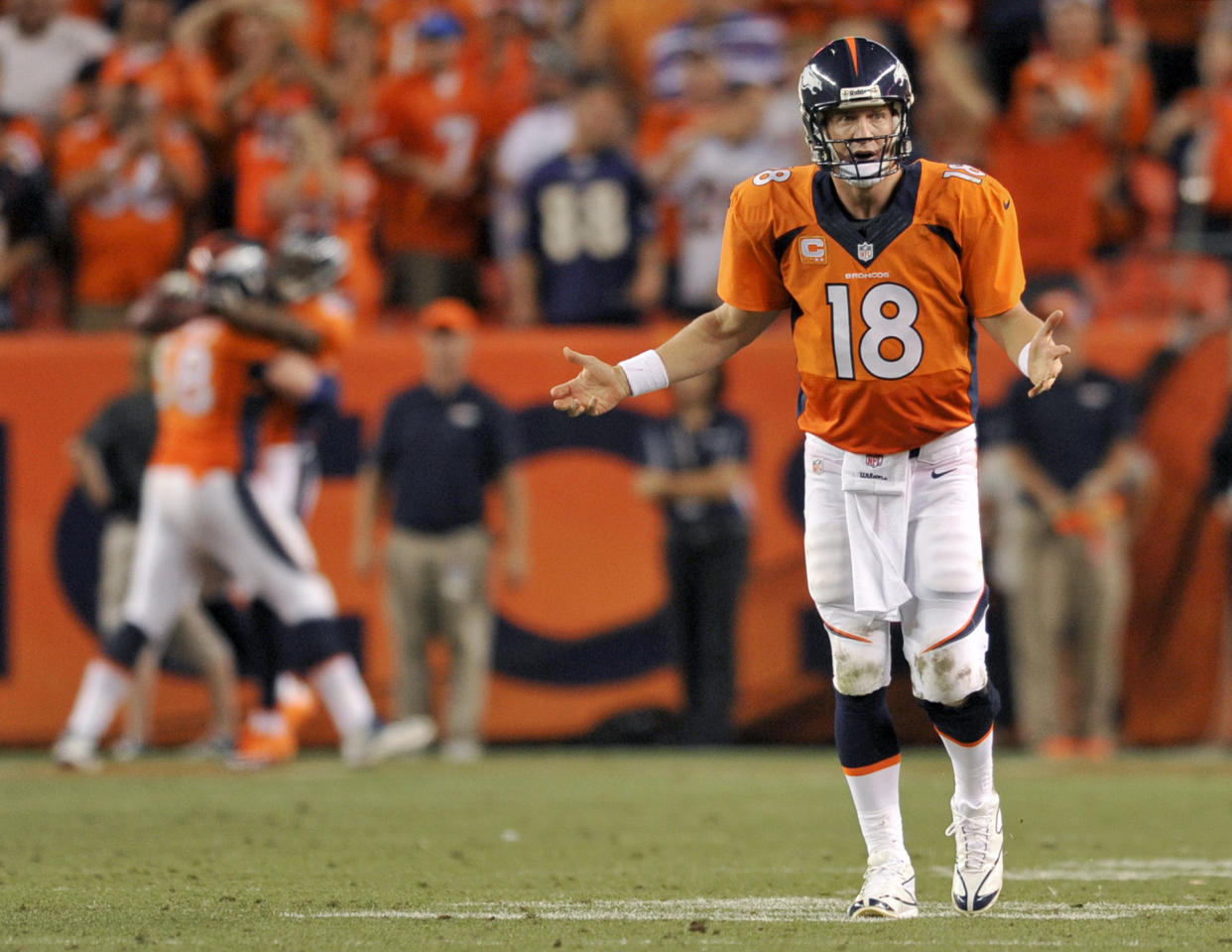 Denver Broncos quarterback Peyton Manning (18) celebrates his seventh touchdown pass of the game against the Baltimore Ravens during the second half of an NFL football game, Thursday, Sept. 5, 2013, in Denver. The Broncos won 49-27. Manning threw a record-tying seven touchdown passes — something no one had done in 44 years. (AP Photo/Jack Dempsey)