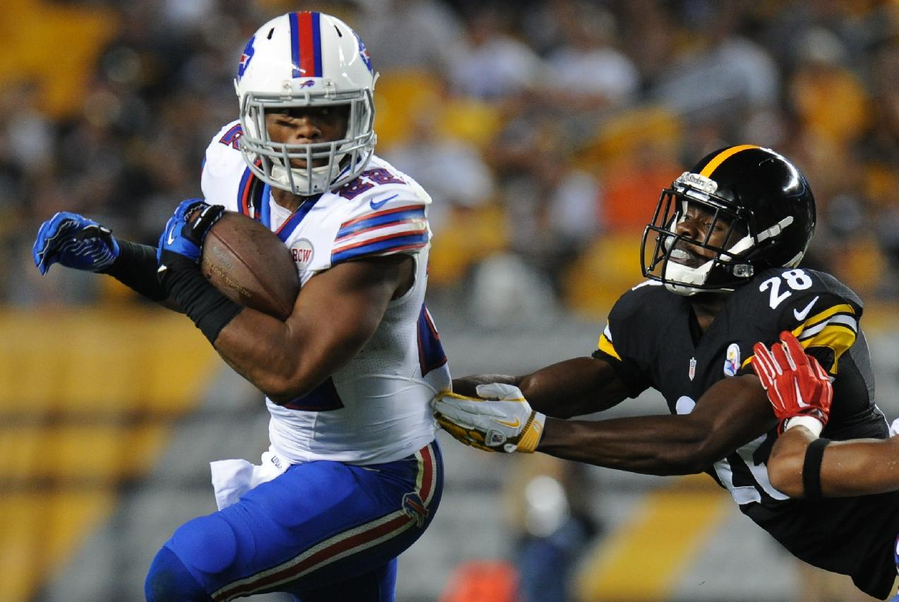 Buffalo Bills running back Fred Jackson (22) gets away from Pittsburgh Steelers cornerback Cortez Allen (28) in the second quarter of the NFL football preseason game on Saturday, Aug. 16, 2014 in Pittsburgh. (AP Photo/Don Wright)