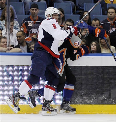 Caps rally from 3-goal hole, top Islanders in SO