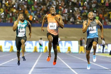 Athletics - Jamaica National Racers Grand Prix - Kingston - 11/06/16 Yohan Blake (L), Usain Bolt (C) and Asafa Powell in action during men's 100m race. REUTERS/Gilbert Bellamy