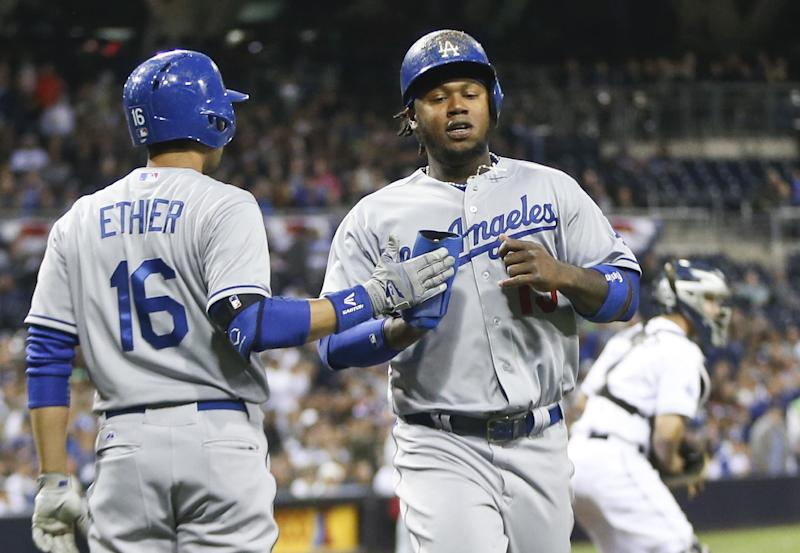 Dodgers finally back home in 1st place