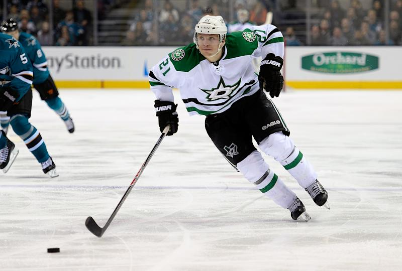 Antoine Roussel of the Dallas Stars skates up ice with control of the puck against the San Jose Sharks during the third period at SAP Center on December 21, 2013 in San Jose, California