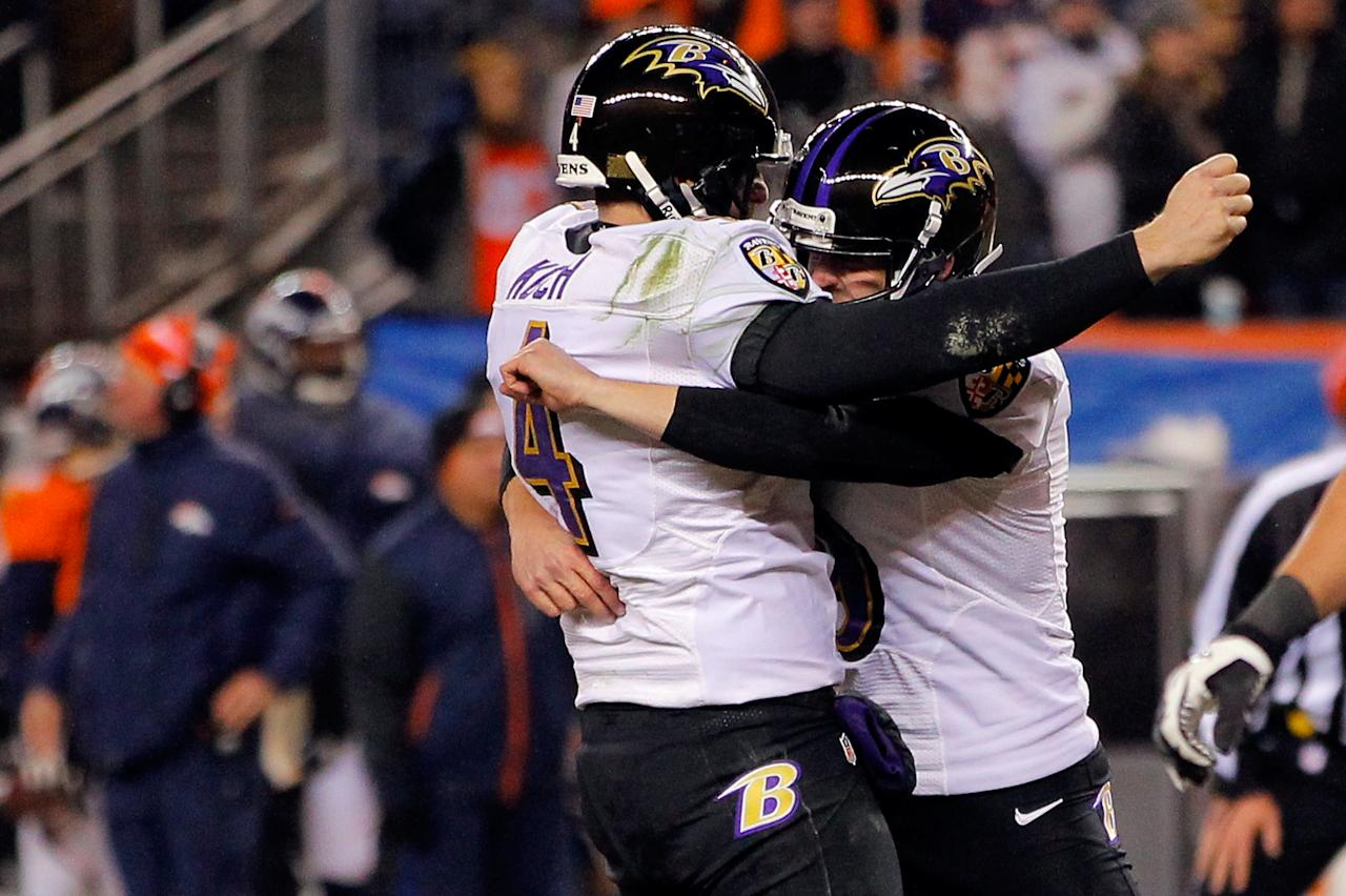 DENVER, CO - JANUARY 12:  (L-R) Sam Koch #4 and Justin Tucker #9 of the Baltimore Ravens celebrate after Tucker kicked a successful game-winning 47-yard field goal in the second overtime against the Denver Broncos during the AFC Divisional Playoff Game at Sports Authority Field at Mile High on January 12, 2013 in Denver, Colorado. The Ravens won 38-35.  (Photo by Doug Pensinger/Getty Images)