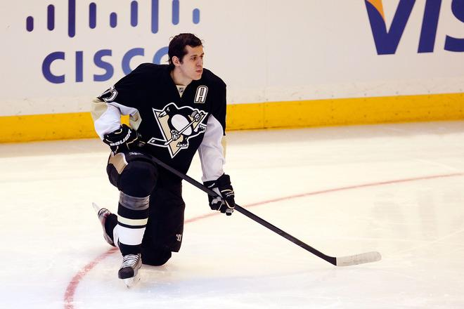 OTTAWA, ON - JANUARY 28:  Evgeni Malkin #71 of the Pittsburgh Penguins and Team Chara kneels on the ice during the 2012 Molson Canadian NHL All-Star Skills Competition at Scotiabank Place on January 28, 2012 in Ottawa, Ontario, Canada.  (Photo by Gregory Shamus/Getty Images)