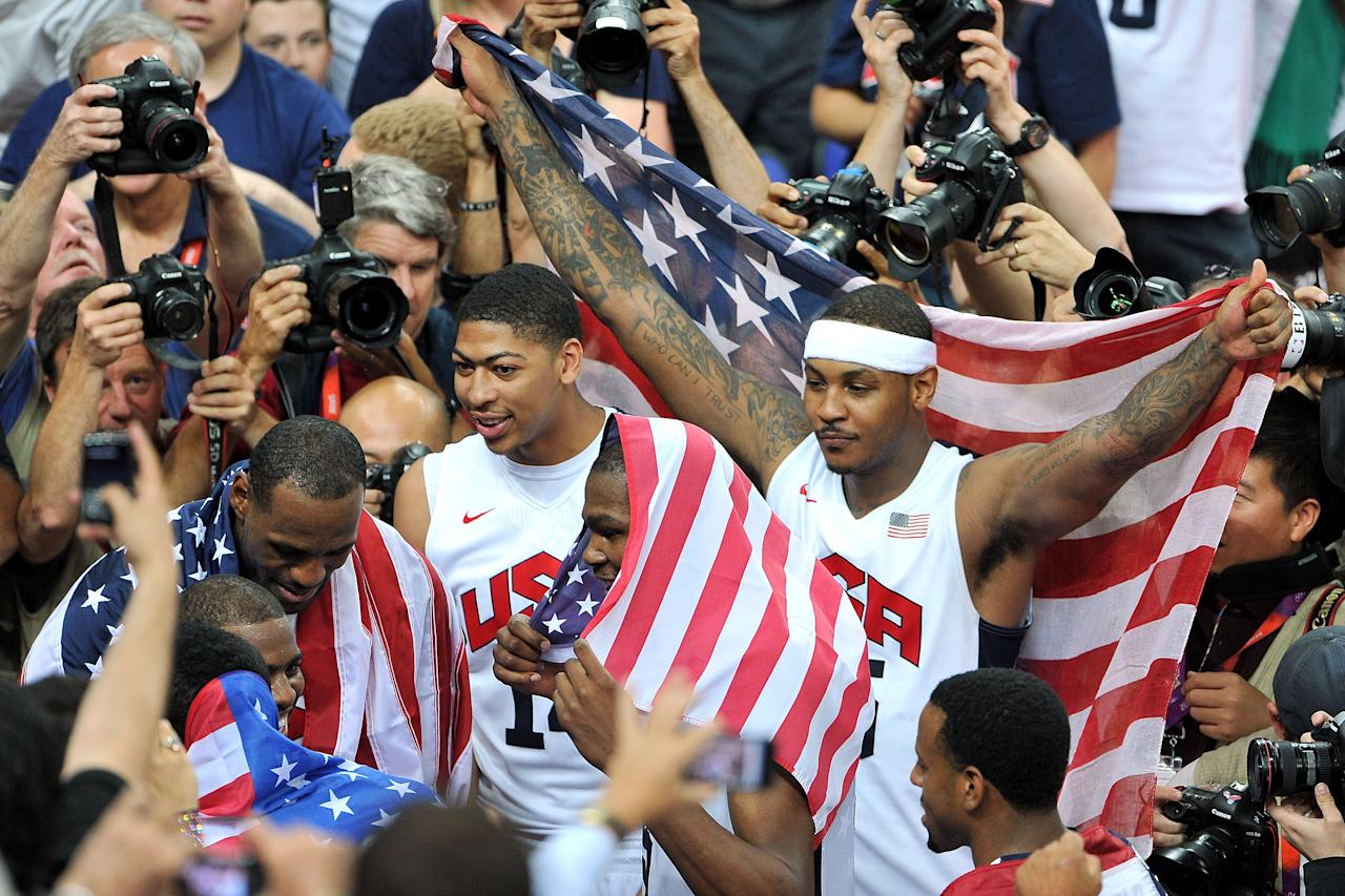 LONDON, ENGLAND - AUGUST 12:  LeBron James #6 of the United States, Kevin Durant #5 of the United States, Carmelo Anthony #15 of the United States, and Anthony Davis #14 of the United States celebrate winning the Men's Basketball gold medal game between the United States and Spain on Day 16 of the London 2012 Olympics Games at North Greenwich Arena on August 12, 2012 in London, England.  (Photo by Pascal Le Segretain/Getty Images)