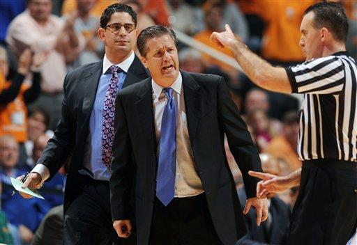 Kentucky head coach John Calipari, center, reactsas a technical foul is called on his team's bench during the first half of an NCAA college basketball game against Tennessee at Thompson-Boling Arena in Knoxville, Tenn., Saturday, Jan. 14, 2012.  Kentucky defeated Tennessee 65-62. (AP Photo/Knoxville News Sentinel, Adam Brimer)
