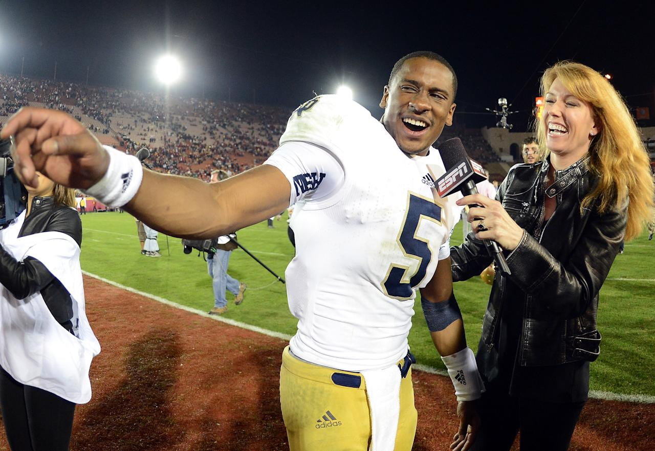 LOS ANGELES, CA - NOVEMBER 24:  Everett Golson #5 of the Notre Dame Fighting Irish smiles as he gives an interview to Heather Cox of ESPN after a 22-13 win over the USC Trojans at Los Angeles Memorial Coliseum on November 24, 2012 in Los Angeles, California.  (Photo by Harry How/Getty Images)