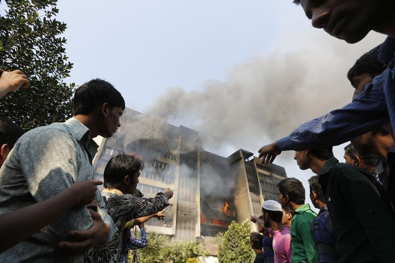 Garment workers gather in front of the Standard Group garment factory which was on fire in Gazipur