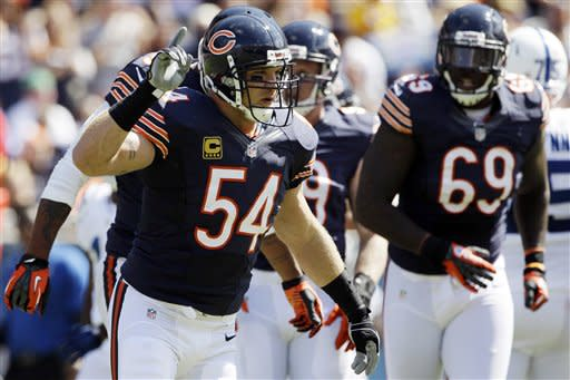 Chicago Bears linebacker Brian Urlacher (54) celebrates after a quarterback sack against the Indianapolis Colts during the first half of an NFL football game in Chicago, Sunday, Sept. 9, 2012. (AP Photo/Nam Y. Huh)
