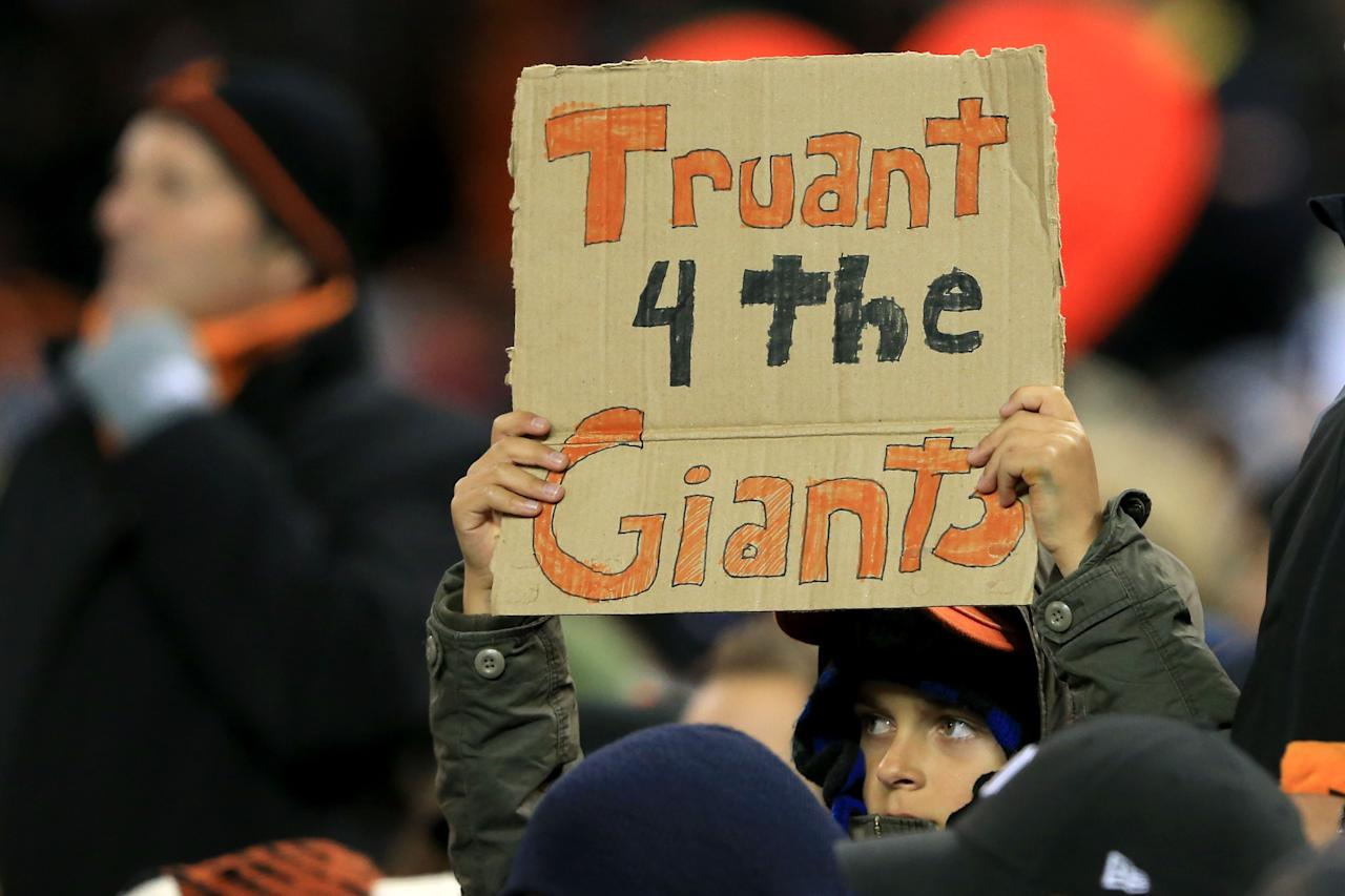 """DETROIT, MI - OCTOBER 28:  A San Francisco Giants fans holds a sign that reads, """"Truant 4 The Giants"""" during Game Four of the Major League Baseball World Series against the Detroit Tigers at Comerica Park on October 28, 2012 in Detroit, Michigan.  (Photo by Doug Pensinger/Getty Images)"""