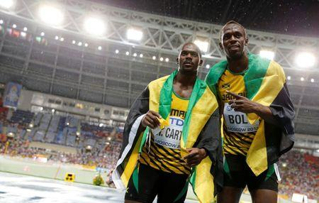 FILE PHOTO: First placed Usain Bolt (R) of Jamaica poses with his compatriot third placed Nesta Carter after competing in the men's 100 metres final during the IAAF World Athletics Championships at the Luzhniki stadium in Moscow August 11, 2013.     REUTERS/Dominic Ebenbichler/File photo   Picture Supplied by Action Images