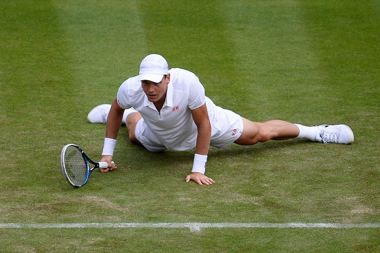 LONDON, ENGLAND - JUNE 25: Tomas Berdych of Czech Republic slips during his Gentlemen's Singles first round match against Martin Klizan of Slovakia on day two of the Wimbledon Lawn Tennis Championships at the All England Lawn Tennis and Croquet Club on June 25, 2013 in London, England. (Photo by Dennis Grombkowski/Getty Images)
