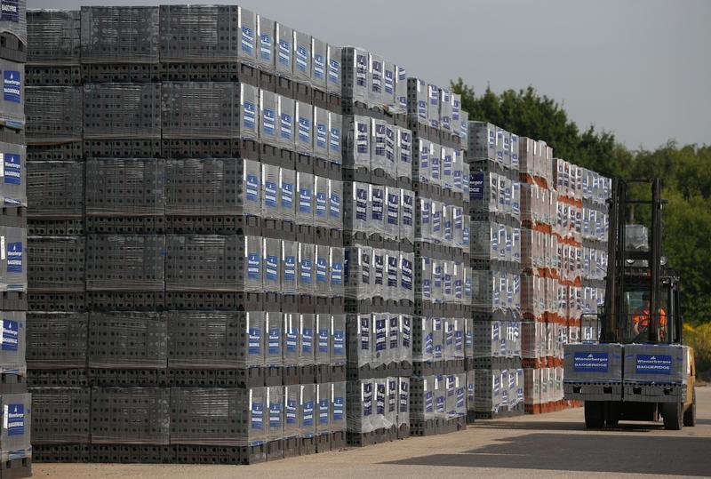A fork lift truck operator drives through the storage area at the Wienerberger Brick Factory in Dosthill