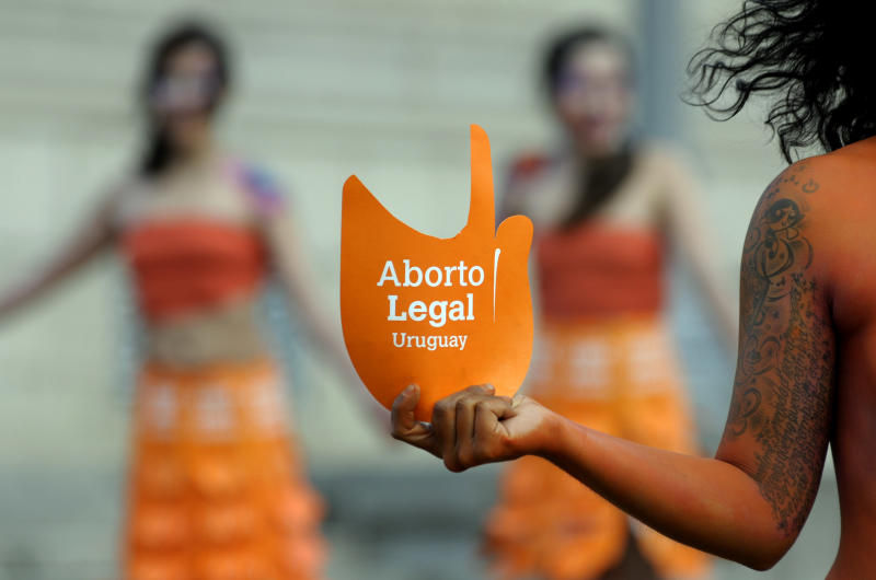 """Pro abortion activists demonstrate in front of the Uruguayan congress in Montevideo, Uruguay, Tuesday, Sept. 25, 2012. Uruguay's congress appeared ready on Tuesday to legalize abortion, a groundbreaking move in Latin America, where no country save Cuba has made abortions accessible to all women during the first trimester of pregnancy. The sign reads in Spanish """"legal abortion.""""  (AP Photo/Matilde Campodonico)"""