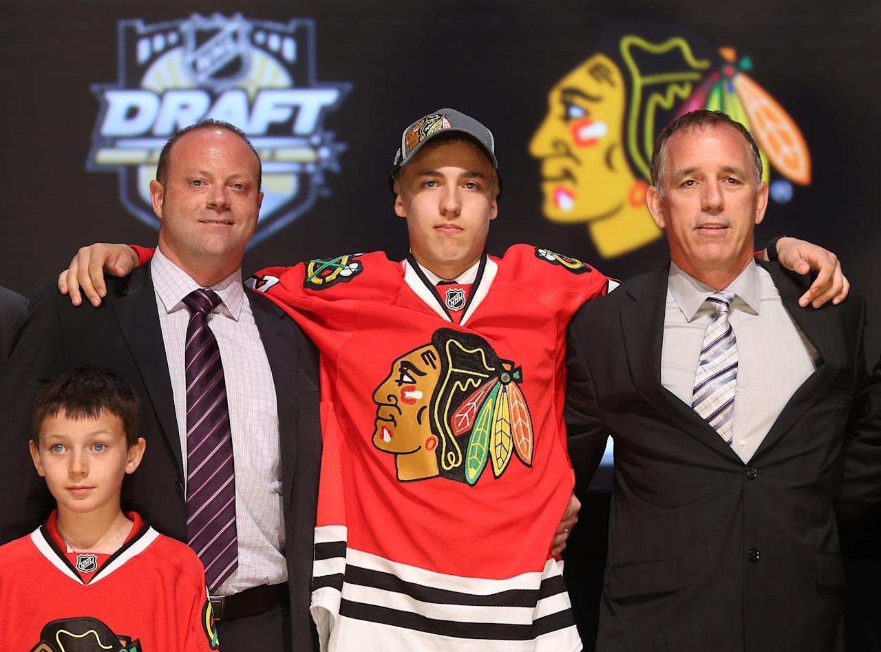 PITTSBURGH, PA - JUNE 22:  Teuvo Teravainen (C), 18th overall pick by the Chicago Blackhawks, poses with Blackhawks representatives on stage during Round One of the 2012 NHL Entry Draft at Consol Energy Center on June 22, 2012 in Pittsburgh, Pennsylvania.  (Photo by Bruce Bennett/Getty Images)