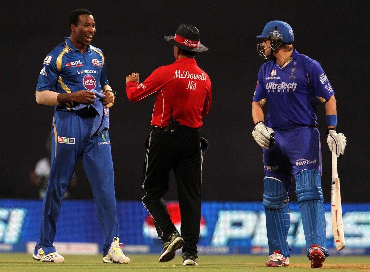 Mumbai Indian player Kieron Pollard and Rajasthan Royals player Shane Watson gets into a argument during match 66 of the Pepsi Indian Premier League ( IPL) 2013  between The Mumbai Indians and the Rajasthan Royals held at the Wankhede Stadium in Mumbai on the 15th May 2013 ..Photo by Vipin Pawar-IPL-SPORTZPICS ..Use of this image is subject to the terms and conditions as outlined by the BCCI. These terms can be found by following this link:..http://www.sportzpics.co.za/image/I0000SoRagM2cIEc