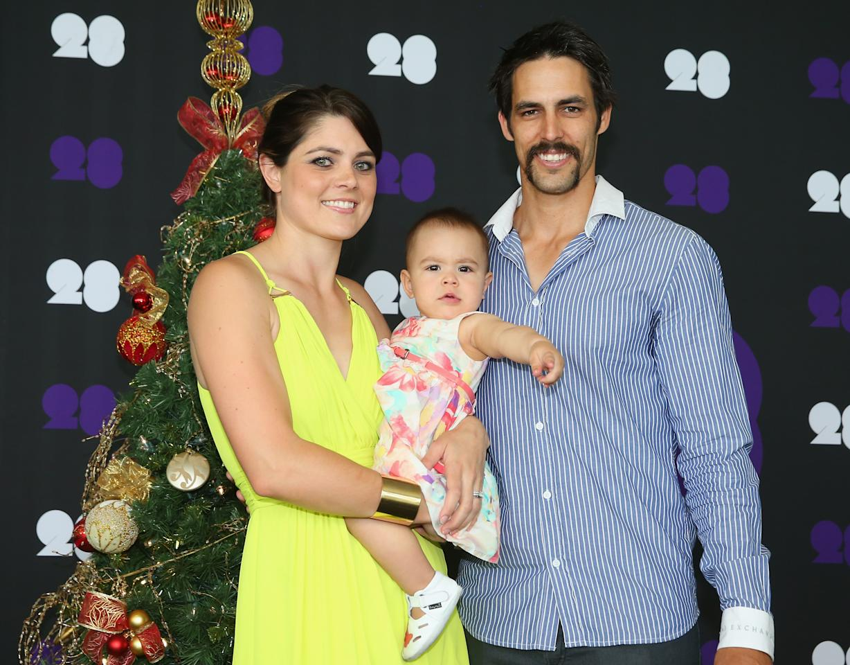 MELBOURNE, AUSTRALIA - DECEMBER 25:  Mitchell Johnson of Australia poses with his wife Jessica Bratich-Johnson and daughter Rubika ahead of the Cricket Australia Christmas Day Lunch at Crown Metropol on December 25, 2013 in Melbourne, Australia.  (Photo by Scott Barbour/Getty Images)