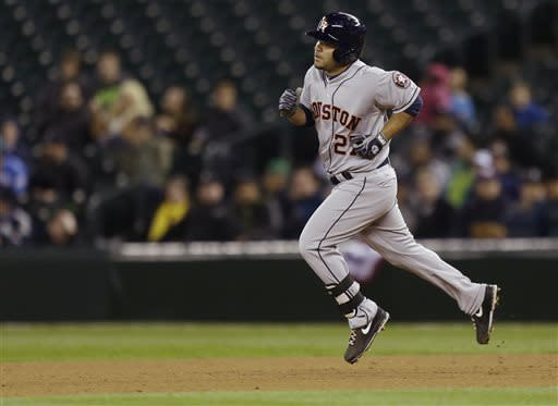 Astros break out of slump, rout Mariners 16-9
