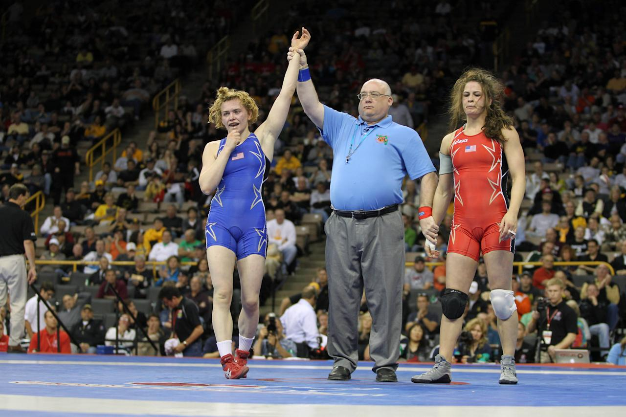 April 22, 2012; Iowa City, IA, USA; Elena Pirozhkova (blue) celebrates her victory over Adeline Gray (red) during the womens 63kg greco finals match at Carver Hawkeye Arena.   Mandatory Credit: Reese Strickland-US PRESSWIRE