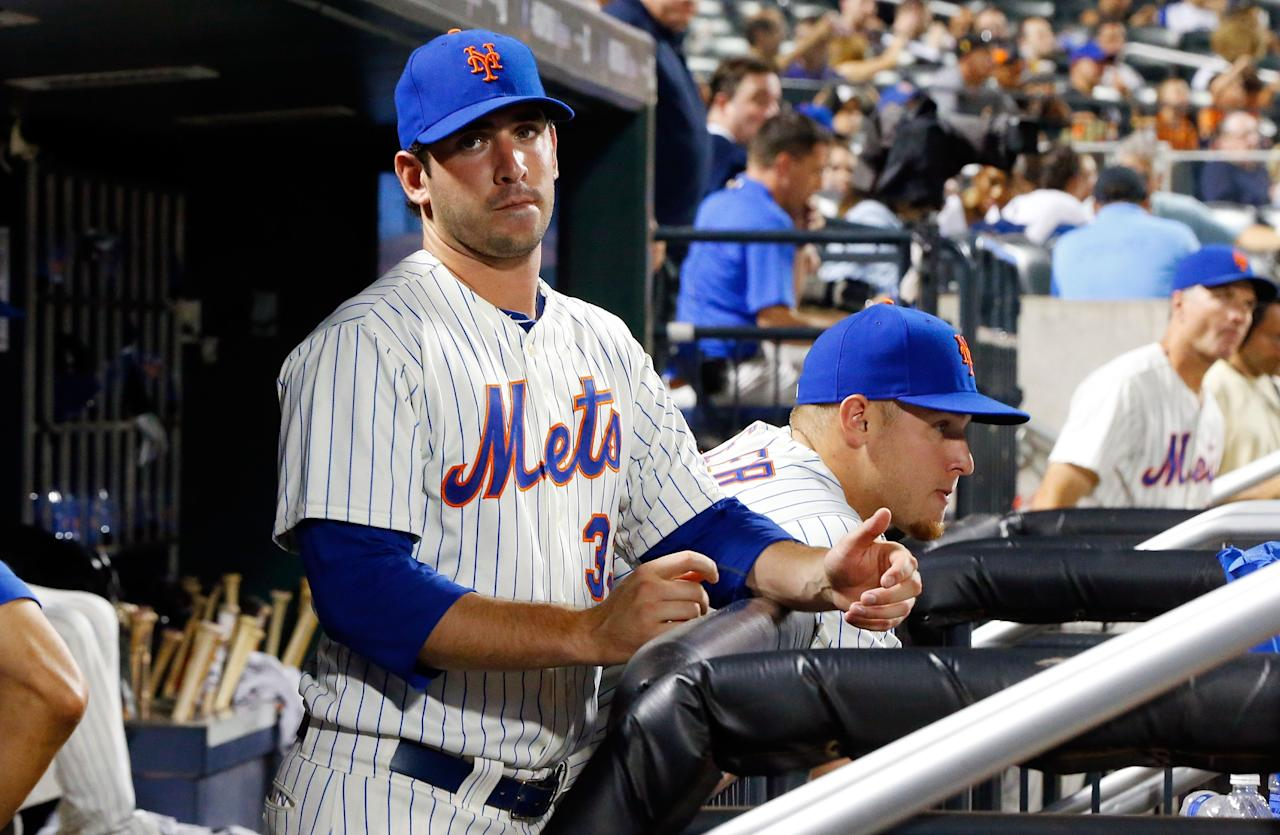 NEW YORK, NY - JULY 19: Matt Harvey #33 and Zack Wheeler #45 of the New York Mets look on from the dugout during a game against the Philadelphia Phillies at Citi Field on July 19, 2013 in the Flushing neighborhood of the Queens borough of New York City. (Photo by Jim McIsaac/Getty Images)