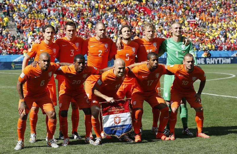 The Dutch team line up for a team photo prior to the group B World Cup soccer match between the Netherlands and Chile at the Itaquerao Stadium in Sao Paulo, Brazil, Monday, June 23, 2014. Left to right first row : Nigel de Jong, Georginio Wijnaldum,Arjen Robben, Jeremain Lens and Wesley Sneijder. 2nd row : unidentified player,  Stefan de Vrij, Ron Vlaar,Daley Blind and Dirk Kuyt