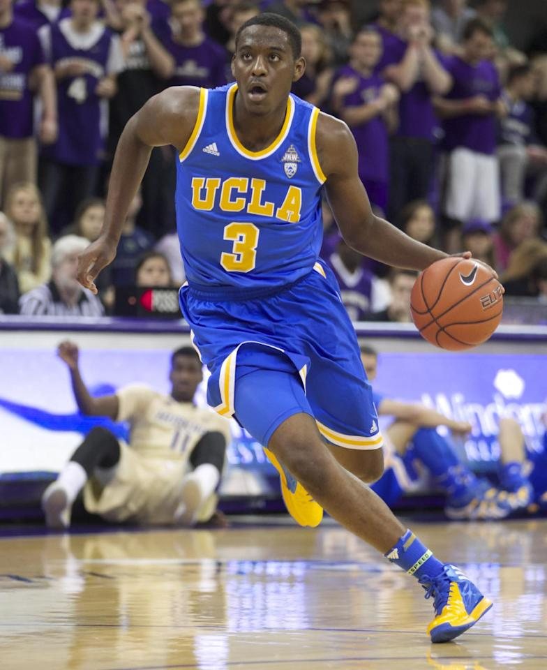 UCLA's Jordan Adams dribbles the ball in first half of an NCAA college basketball game against Washington, Thursday March 6, 2014, in Seattle. UCLA defeated Washington 91-82. (AP Photo/Stephen Brashear)
