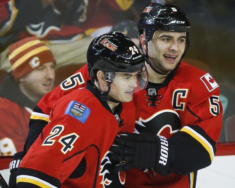Flames beat Sharks 4-1 to win fourth straight