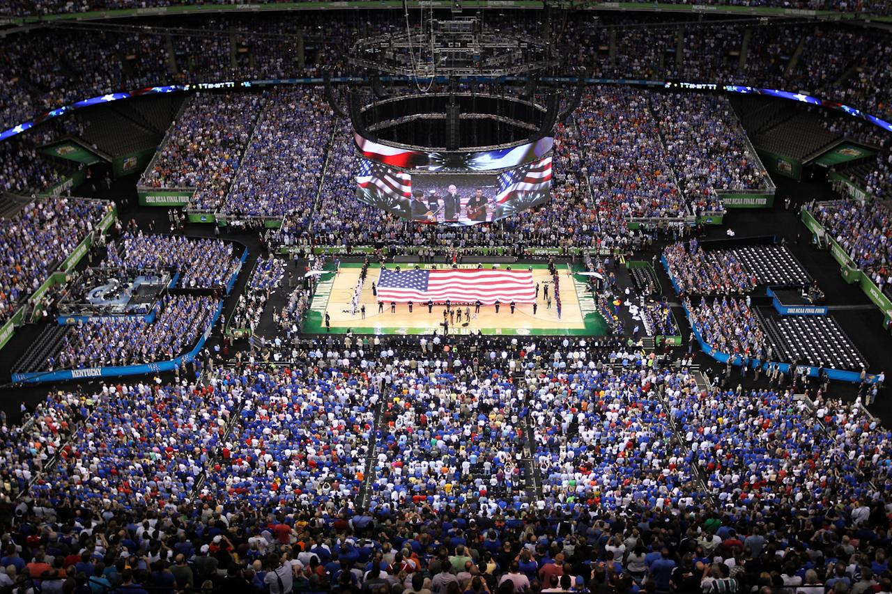 A general view as The Fray performs the national anthem before the Kentucky Wildcats take on the Kansas Jayhawks in the National Championship Game of the 2012 NCAA Division I Men's Basketball Tournament at the Mercedes-Benz Superdome on April 2, 2012 in New Orleans, Louisiana. (Photo by Chris Graythen/Getty Images)