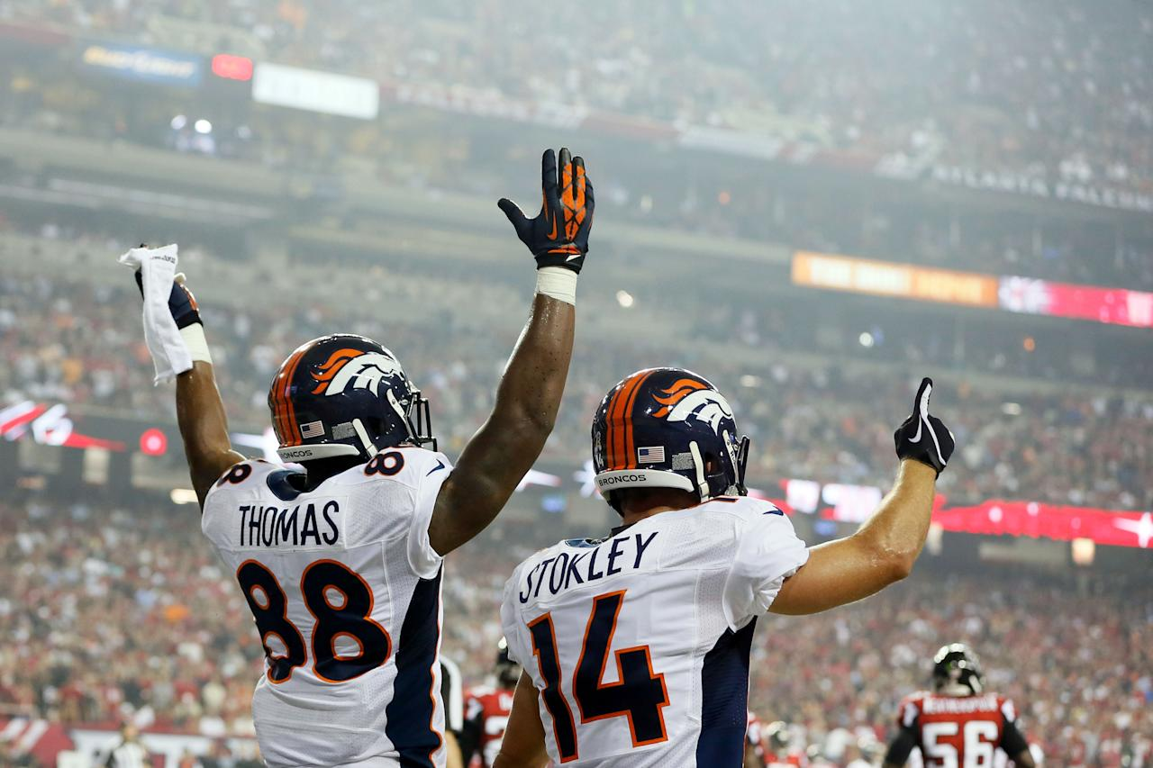 ATLANTA, GA - SEPTEMBER 17:  Wide receiver Demaryius Thomas #88 and wide receiver Brandon Stokley #14 of the Denver Broncos celebrate after a touchdown in the second quarter against the Atlanta Falcons during a game at the Georgia Dome on September 17, 2012 in Atlanta, Georgia.  (Photo by Kevin C. Cox/Getty Images)