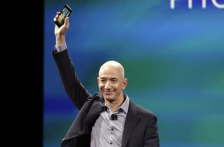 Amazon CEO Jeff Bezos shows off his company's new smartphone, the Fire Phone, in Seattle, Washington