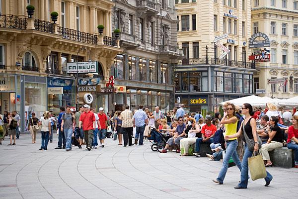 """<b>5. (Tied) Austria</b> <br>Highest income tax rate: 50% <br>Average 2010 income: $50,700 <br><br>Austria, which is often ranked as one of the world's best places to live, levies a high income tax and social security burden on households.  <br><br>Its highest marginal tax rate comes into effect at $80,000 of taxable income. The country's social security rate ranges from 17 percent to 18 percent. Special payments for workers like a holiday bonus are also taxed at 6 percent, up to a limit of one-sixth of the annual income. Annual property tax is levied by municipalities at a rate of 0.5 percent to 1 percent of the property's value. Other notable taxes include a capital gains tax of 25 percent.  <br><br>In April, the Austrian government nailed down a crucial deal with Switzerland to<a href=""""http://www.reuters.com/article/2012/04/13/austria-switzerland-tax-idUSL6E8FD4JK20120413""""> tax money stashed away</a> by its citizens in secret Swiss bank accounts. The existing funds will be taxed between 15 percent to 38 percent based on the size of the deposits and is expected to bring in $1.3 billion in revenue starting in 2013. The government estimates about $12 billion to $20 billion in undeclared funds are parked in Swiss accounts. <br><br>Pictured: Street in Vienna"""