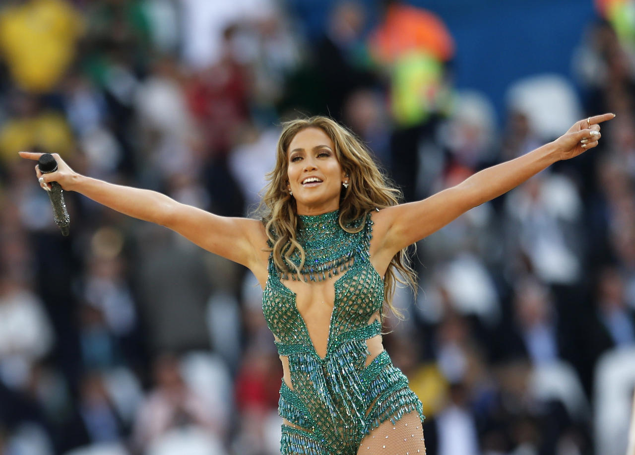 United States singer Jennifer Lopez performs during the 2014 World Cup opening ceremony ahead of the group A soccer match between Brazil and Croatia, the opening game of the tournament, in the Itaquerao Stadium in Sao Paulo, Brazil, Thursday, June 12, 2014. (AP Photo/Frank Augstein)