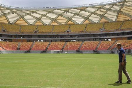 United States national soccer team coach Klinsmann of Germany inspects the field of the Arena Amazonia stadium in Manaus