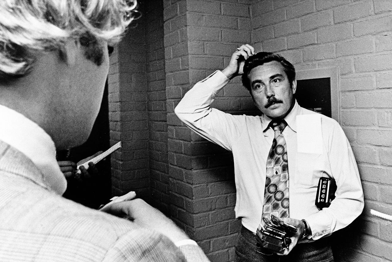 """FILE - In this Aug. 1, 1975 file photo Bloomfield Township Police Chief Robert Snell fields questions from reporters about the mysterious disappearance of former Teamster president Jimmy Hoffa. Hoffa was reported missing on July 31, 1975, after meeting with reputed Detroit mob enforcer Anthony """"Tony Jack"""" Giacalone and alleged New Jersey mob figure Anthony """"Tony Pro"""" Provenzano at a restaurant in Bloomfield Township, Mich. (AP File Photo)"""