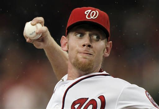 Washington Nationals starting pitcher Stephen Strasburg throws during the second inning of a baseball game with the Atlanta Braves at Nationals Park on Tuesday, Aug. 21, 2012, in Washington. (AP Photo/Alex Brandon)