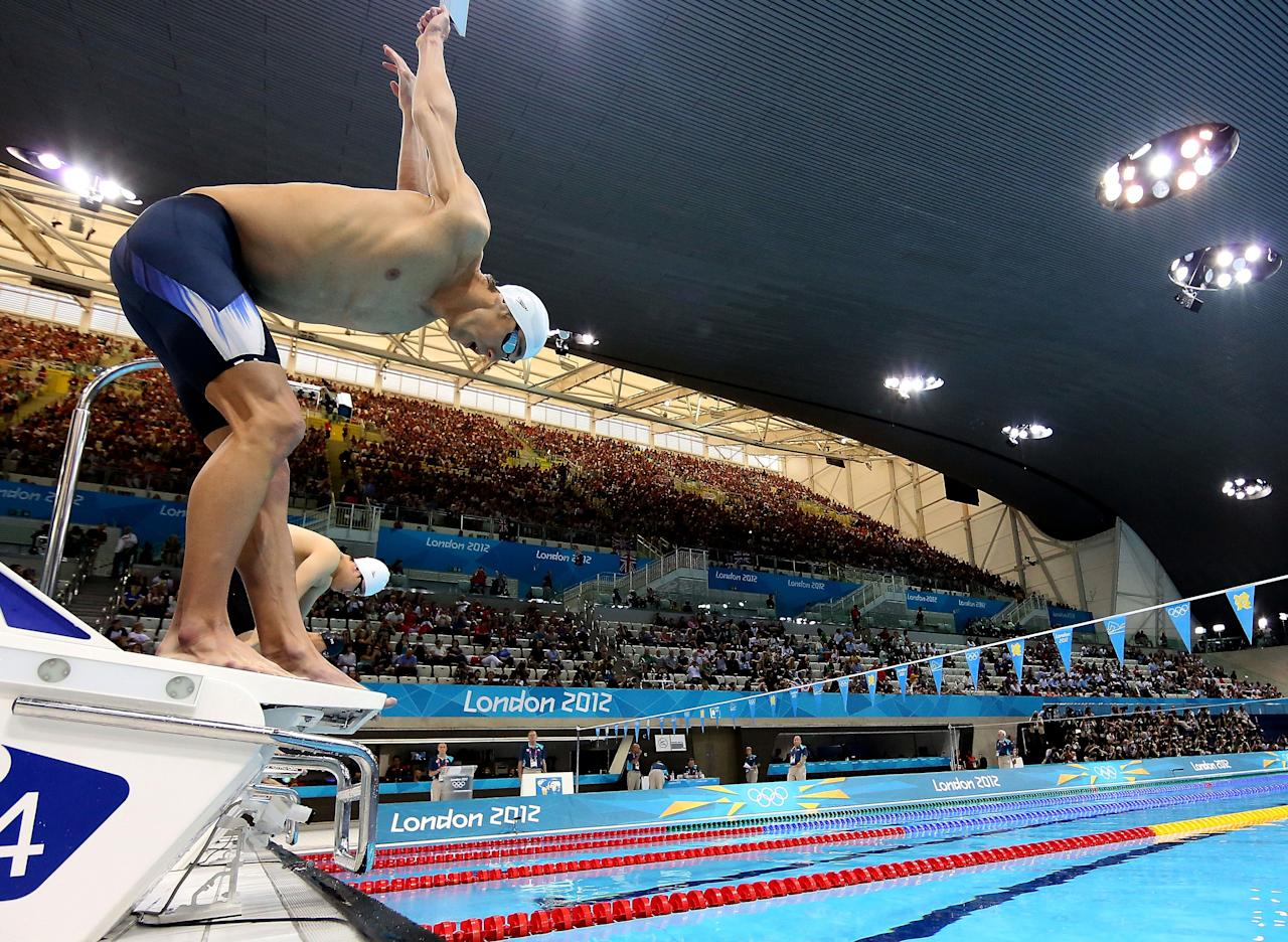 CORRECTS ATHLETE NAME TO MICHAEL PHELPS- United States swimmer Michael Phelps dives off of the starting block during the men's 400-meter individual medley event during the 2012 Summer Olympics at the Aquatics Centre in London on Saturday, July 28, 2012, in London. (AP Photo/Al Bello, Pool)