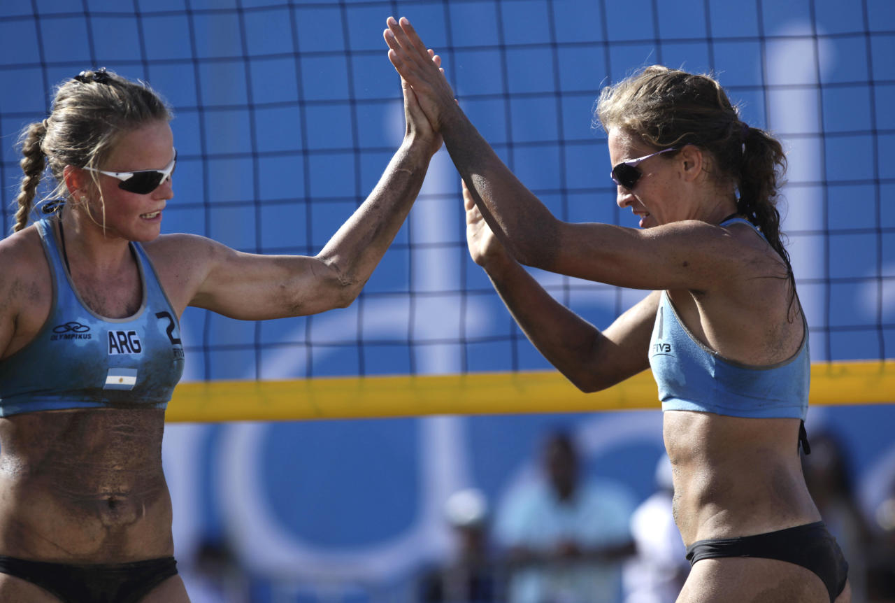 Argentina's Zonta Maria, left, Gallay Maria celebrate a point during a women's beach volleyball match against Puerto Rico at the Pan American Games in Puerto Vallarta, Mexico, Tuesday Oct. 18, 2011. (AP Photo/Ariana Cubillos)
