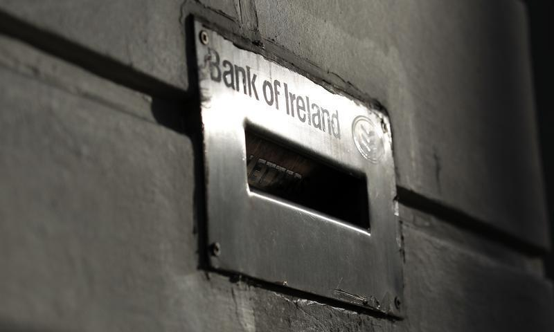 Sunlight is reflected off a deposit box on the exterior of a Bank Of Ireland branch in Belfast