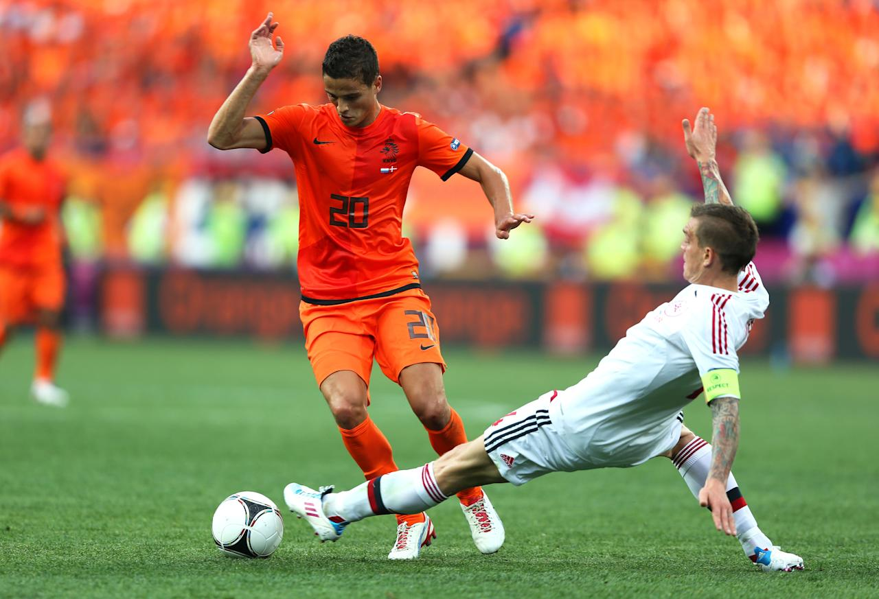 KHARKOV, UKRAINE - JUNE 09:  Daniel Agger of Denmark tackles Ibrahim Afellay of Netherlands during the UEFA EURO 2012 group B match between Netherlands and Denmark at Metalist Stadium on June 9, 2012 in Kharkov, Ukraine.  (Photo by Ian Walton/Getty Images)