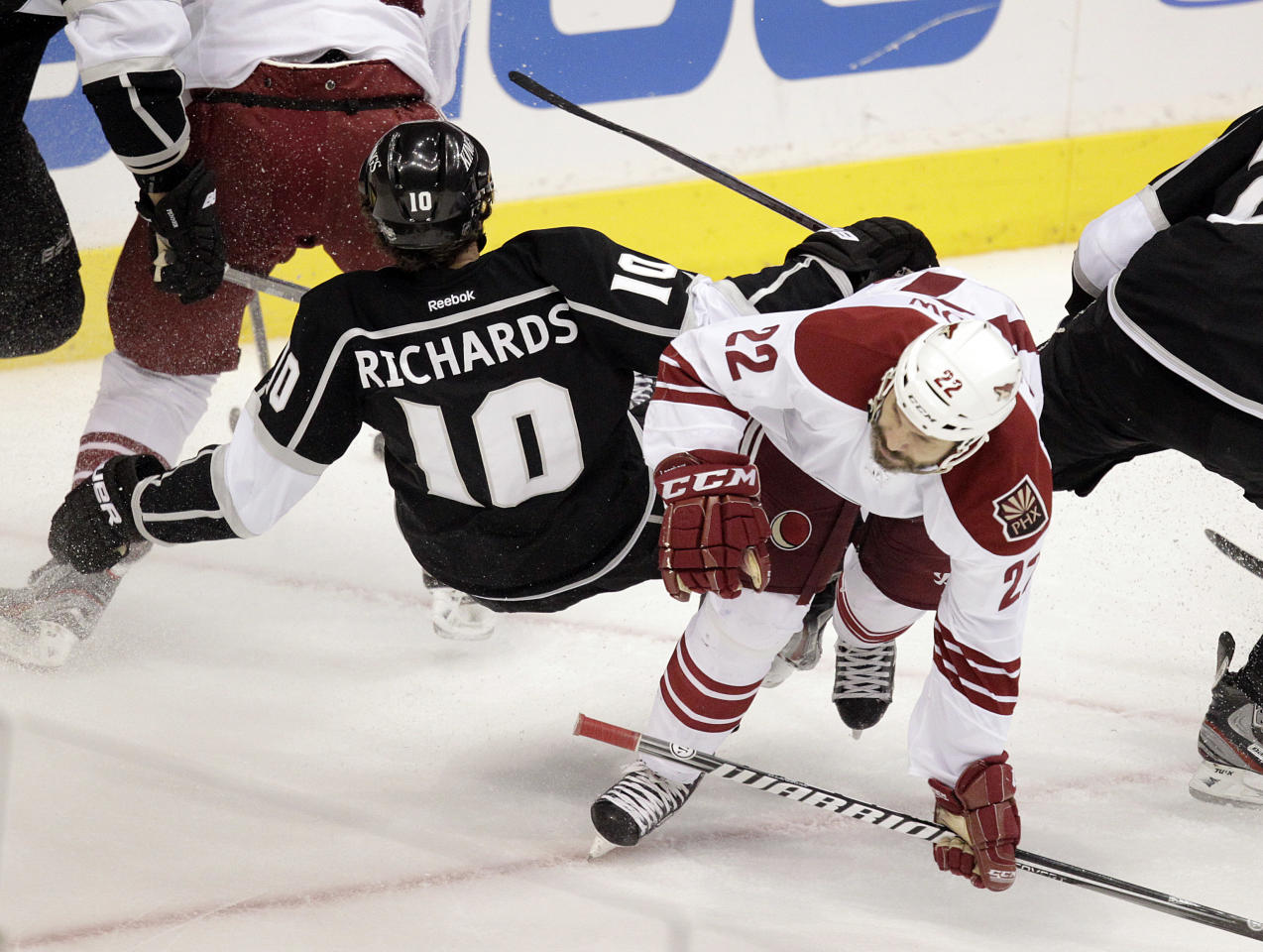 Los Angeles Kings center Mike Richards, left, collides with Phoenix Coyotes center Daymond Langkow during the first period of Game 4 of the NHL hockey Stanley Cup Western Conference finals in Los Angeles, Sunday, May 20, 2012. (AP Photo/Jae C. Hong)