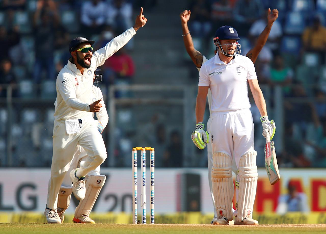 Cricket - India v England - Fourth Test cricket match - Wankhede Stadium, Mumbai, India - 12/12/16. India's Virat Kohli (L) celebrates the wicket of England's Jonny Bairstow. REUTERS/Danish Siddiqui