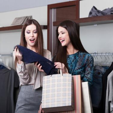 Two-girlfriends-go-shopping-laughing_web
