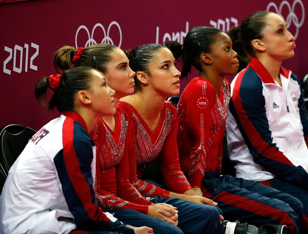 LONDON, ENGLAND - JULY 31:  (L-R) Kyla Ross, Mc Kayla Maroney, Alexandra Raisman, Gabrielle Douglas and Jordyn Wieber of the United States watch during the Artistic Gymnastics Women's Team final on Day 4 of the London 2012 Olympic Games at North Greenwich Arena on July 31, 2012 in London, England.  (Photo by Jamie Squire/Getty Images)