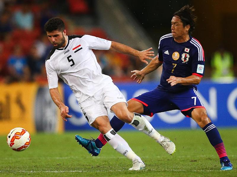 Yasuhito Endo (R) of Japan fights for the ball with Iraq's Yaser Safa Kasim during their first round AFC Asian Cup match, at the Suncorp Stadium in Brisbane, on January 16, 2015