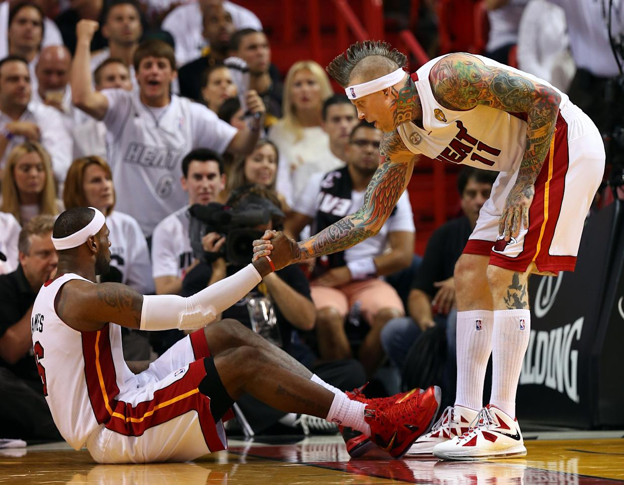 MIAMI, FL - JUNE 18:  LeBron James #6 is helped up by Chris Andersen #11 of the Miami Heat while taking on the San Antonio Spurs during Game Six of the 2013 NBA Finals at AmericanAirlines Arena on June 18, 2013 in Miami, Florida. NOTE TO USER: User expressly acknowledges and agrees that, by downloading and or using this photograph, User is consenting to the terms and conditions of the Getty Images License Agreement.  (Photo by Mike Ehrmann/Getty Images)