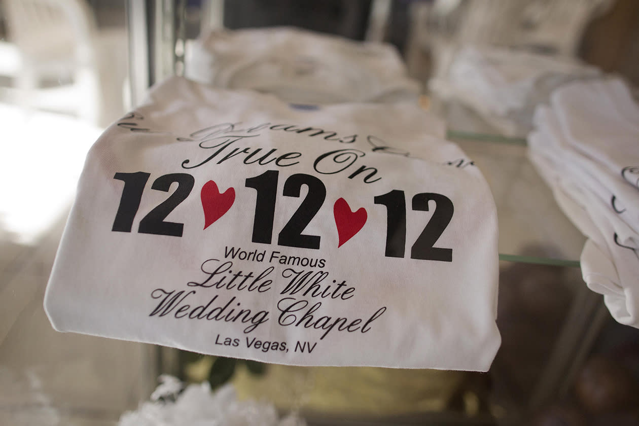 Tee shirts advertising the 12-12-12 date sit on display at A Little White Wedding Chapel in Las Vegas.