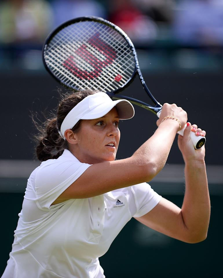 LONDON, ENGLAND - JUNE 25: Laura Robson of Great Britain plays a backhand during her Ladies' Singles first round match against Maria Kirilenko of Russia on day two of the Wimbledon Lawn Tennis Championships at the All England Lawn Tennis and Croquet Club on June 25, 2013 in London, England. (Photo by Dennis Grombkowski/Getty Images)